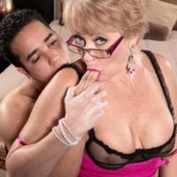 Glasses wearing MILF over 50 Tracy Licks seducing younger man with a handjob