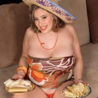 Big boobed Latina plumper Selena Castro eating food while displaying hooters