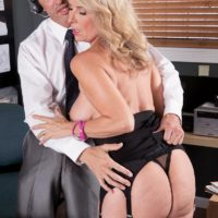 Mature blonde woman Laura Layne seducing sex from co-worker in her office