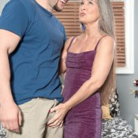 Mature lady Leilani Lei and younger man undressing each other on her bed