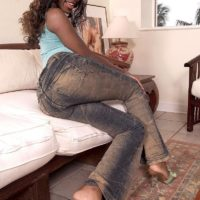 Ebony amateur Sapphira freeing big booty from thong panties and denim jeans