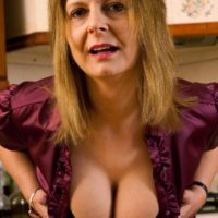 Mature blonde housewife lets her big natural boobs loose in her kitchen