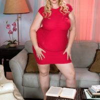 Blonde BBW Lila Lovely uncovers her hooters as she removes her dress