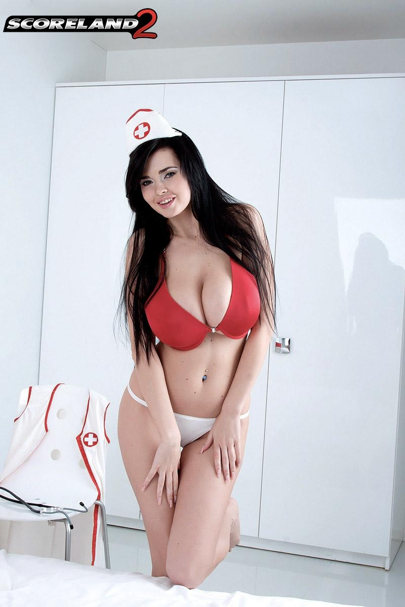 Dark haired nurse Sha Rizel peels off her uniform to pose in her bra and panties