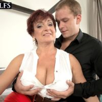 Mature lady Jessica Hot lets her big tits hang while getting fucked by her boy toy