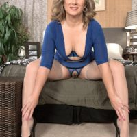 Older blonde woman Catrina Costa teases her tied up lover in stockings and heels