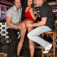 Sexy MILF Patty Michova gives two men blowjobs at the same time in a bar