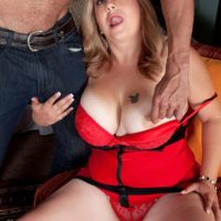 Blonde BBW Dani Moore exposes her big boobs before giving a blowjob in lingerie