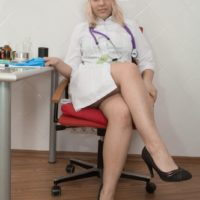 Blonde nurse Jill undresses in her office to display her hairy pussy in high heels