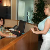 Blonde secretary Summer Sinn flashes her huge boobs at the office in a long skirt