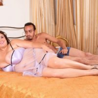 Fat female Charlie Cooper pleasures her man with her massive tits in sheer lingerie