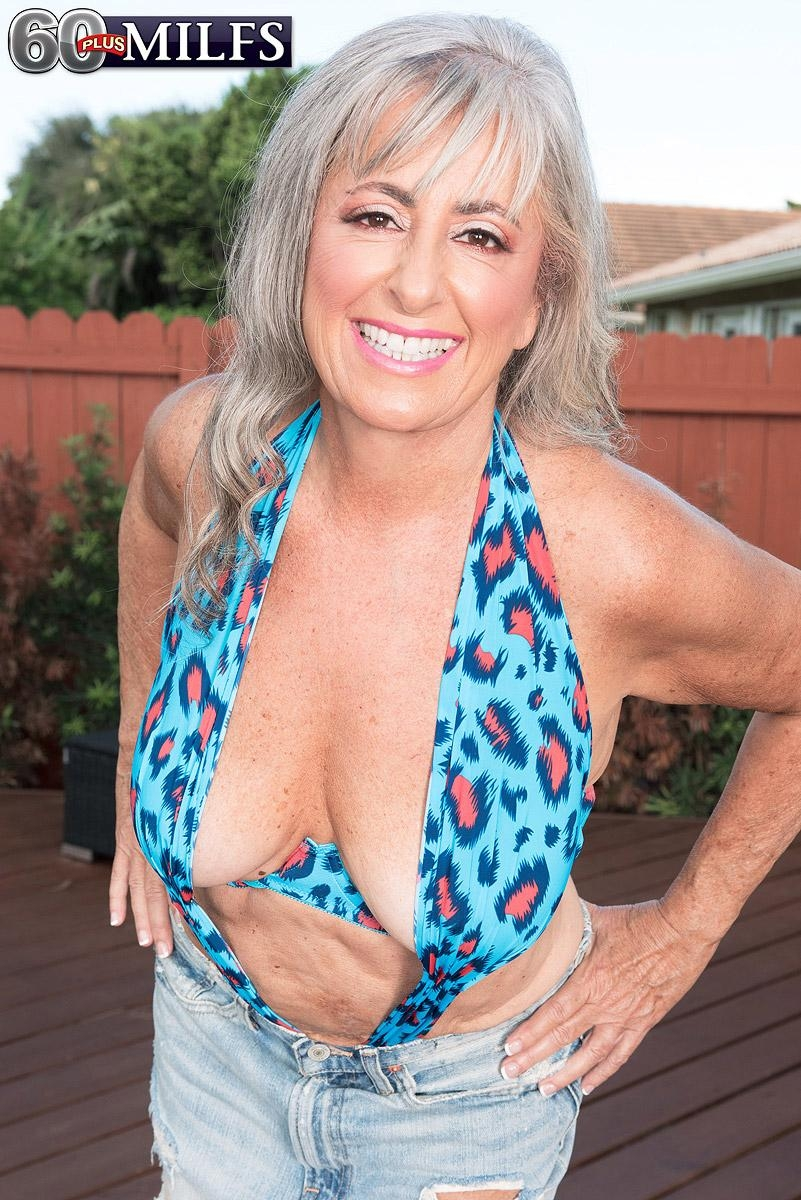 Hot 60 plus MILF Silva Foxx seduces a younger man by flashing her tits in a denim skirt