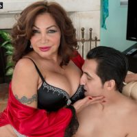 Mature lady Sandra Martines seduces a younger man in bra and panties combo