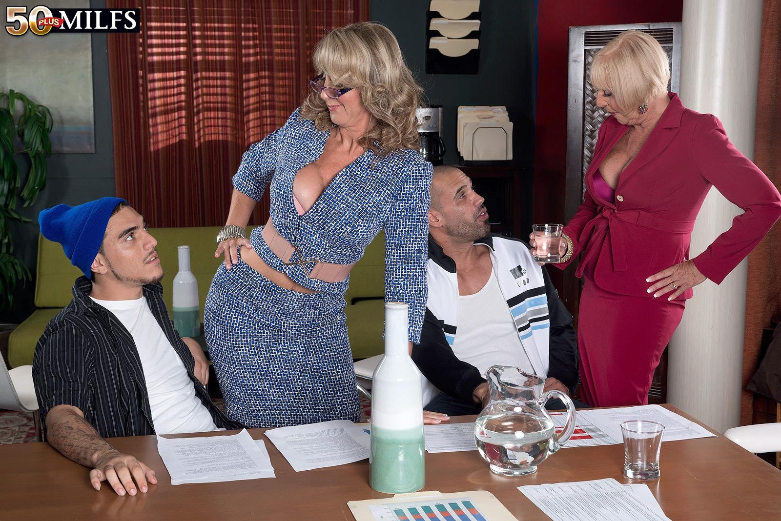 Mature women Jenna Covelli and Scarlet Andrews seduce younger men at a diner