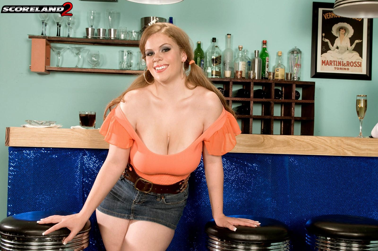 Solo girl Jessica Taylor whips out her big boobs at the bar with hair up in pigtails