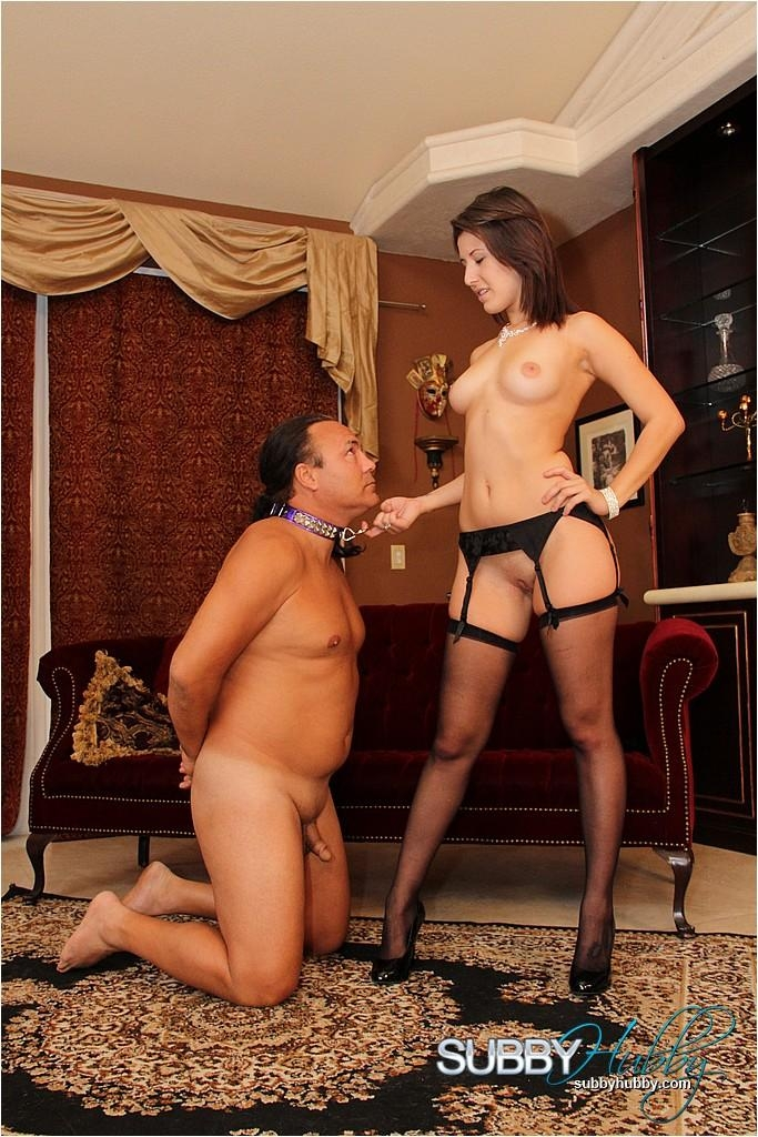 Brunette wife Missy Daniels puts a collar on her male sub and tramples him