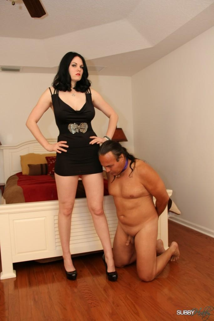 Dark haired wife Shae Fatale hog ties her male before stripping to her lingerie and heels