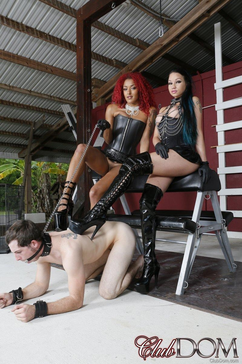 Dominatrix Daisy Ducati and her girlfriend dominate a male sub in high heels