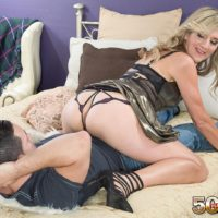 Hot mature woman Lauren De Wynter seduces younger man and gives him a blowjob