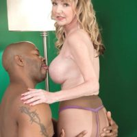 Petite granny Janee Diamond exposes her big tits before sucking a big black dick