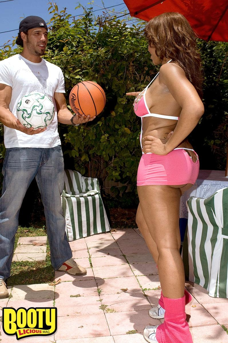 Black girl Ayana Angel flaunts her big booty in a short skirt while dribbling a basketball