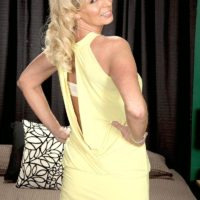 Blonde grandmother Nikki Chevious works on seducing a black stud in a yellow dress