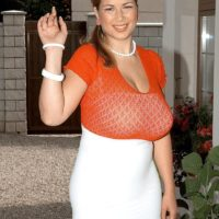 Busty MILF Terry Nova licks her own nipples and a cock at the same time in a white skirt