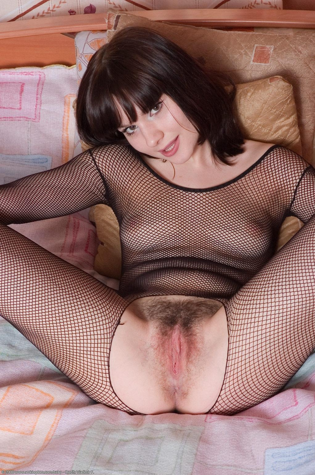 Dark haired amateur plays with her hairy pussy in a crotchless bodystocking