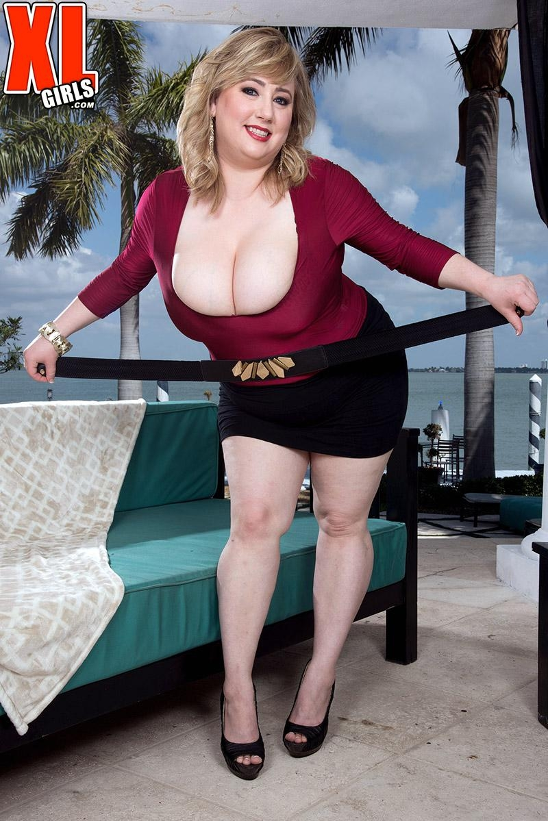 Fat blonde chick Laddie Lynn flashes her upskirt panties along with her ample cleavage