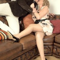 Mature blonde woman gets around to giving a blowjob after foreplay in stockings