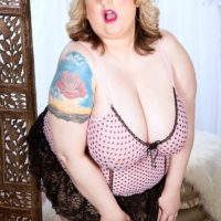 Obese solo girl Porsche Dali teasing the pierced nipples of her massive breasts