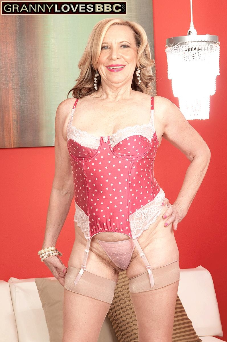 Petite granny Miranda Torri has her erect nipples licked by her younger black lover