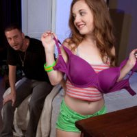 Petite teen girl Marissa Mae exposes her tiny boobs attired in a pair of shorts