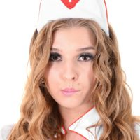 Solo model Alina N works herself free from her naughty nurse unfiorm