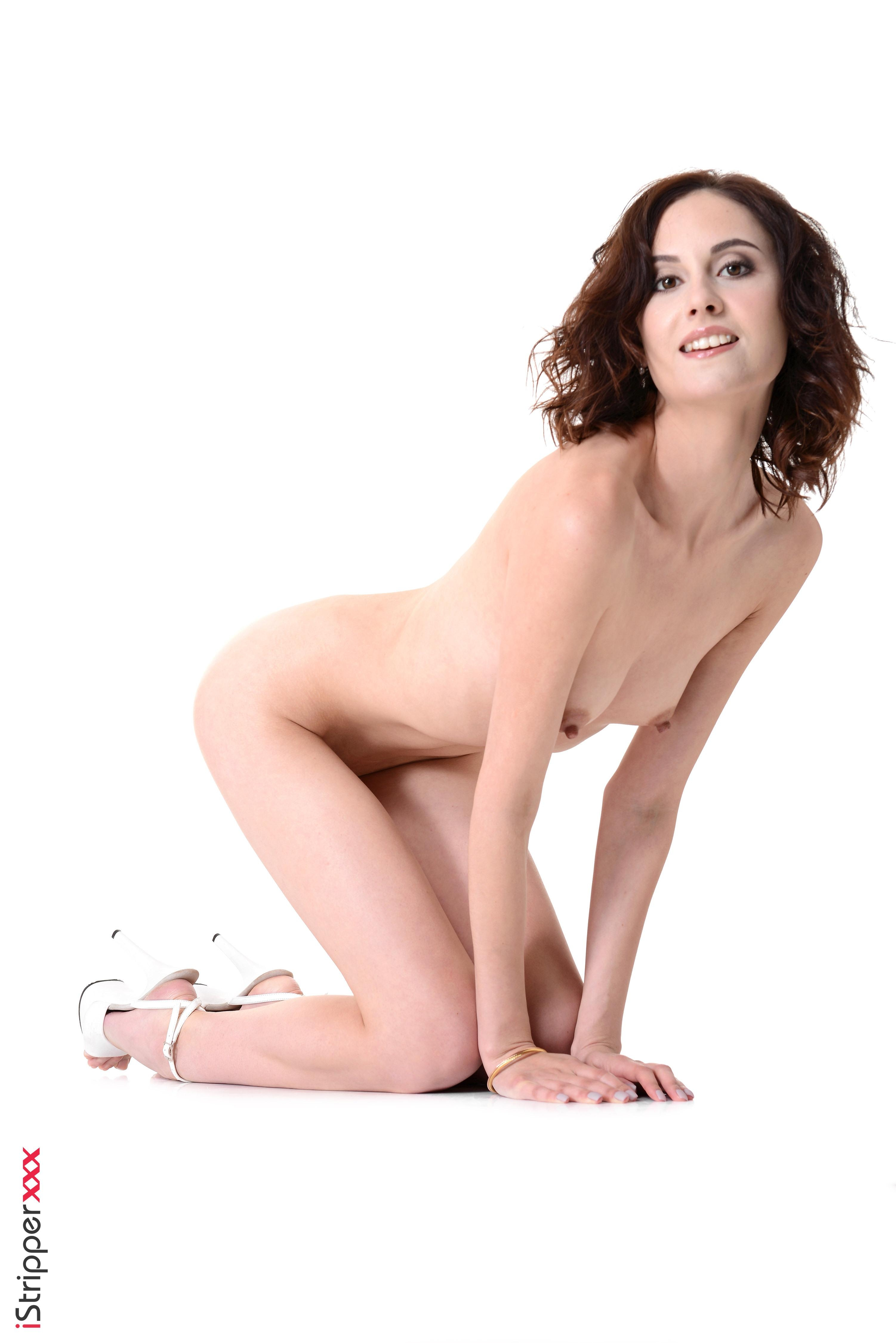 Solo model Sade Mare inserts a big dildo into her shaved pussy after stripping naked