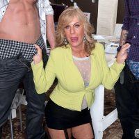 Over 60 blonde MILF Phoenix Skye blowing big cocks in MMF threesome