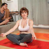 Busty 60 plus MILF Bea Cummins baring big tits in yoga pants and thong panties