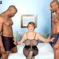 Busty 60 plus MILF Bea Cummins jerking BBC in interracial three way sex fest
