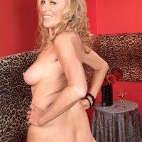 Busty blonde mature woman Bethany James flashing big tits and upskirt panties