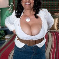 Busty over 60 brunette MILF Rochelle Sweet baring huge tits for nipple play
