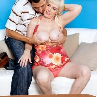 Busty short haired granny Lola Lee giving big cock blowjob and titjob in pantyhose