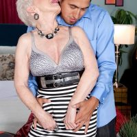 Over 60 MILF pornstar Jewel having big tits freed from dress in stockings and heels