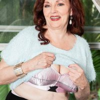 Redhead MILF over 60 Katherine Merlot baring large saggy tits for nipple play