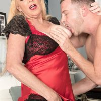 Stocking and lingerie attired 60 plus blonde MILF Charlie baring big tits for nip play