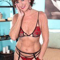 Stocking, garter and lingerie clad 60 plus MILF Sydni Lane baring ass for sex acts