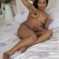 Barefoot ebony amateur Alishaa Mae freeing big tits and hairy pussy from lingerie