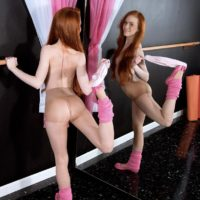 Barely legal redhead teen Dolly Little revealing small tits and phat ass in leg warmers