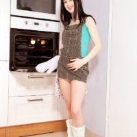 Boots wearing brunette amateur Lolly exposing tiny teen tits and phat as in kitchen
