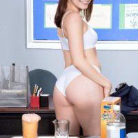 Brunette spinner Kylie Quinn exposing small tits on desk in socks and panties