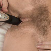 Busty European amateur Darina Nikitina toying hairy pussy while masturbating